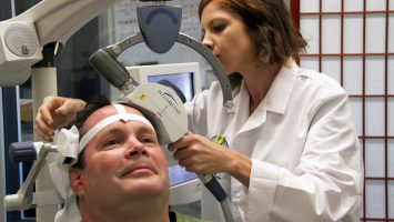 A technician calibrates a transcranial magnetic stimulation (TMS) machine during a therapy session at UCLA Health. Bob Holmes, of Los Angeles, is being treated with TMS for depression, but experts at UCLA want to study the therapy to see if it can be an effective alternative to opioids for patients with chronic pain.